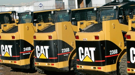 Caterpillar reported adjusted earnings per share of $. for the third quarter, easily topping analyst views and revenue also rose to $. billion. Shares jumped % in pre-market trade.