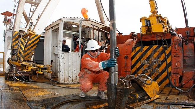 Oil Worker Operates Drill 2