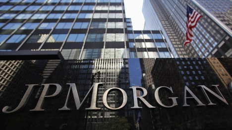 J.P. Morgan Chase  Co. said its third-quarter revenue declined as the bank wrestled with volatile markets and continued low interest rates.