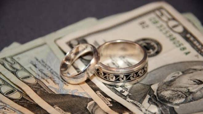 stock-money-bills-cash-wedding-rings.jpg