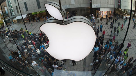 Apple's fourth-quarter earnings easily topped Wall Street estimates, helped in part by the release of new iPhone devices at the tail end of the period.