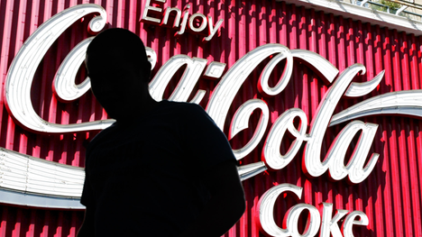Coca-Cola posted declining earnings and revenue in the third quarter, and unveiled a new cost-cutting plan to reduce $ billion per year by .