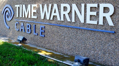 Charter struck a $ billion cash-and-stock deal for Time Warner Cable, a % premium to TWC's last closing price.