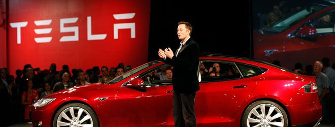Tesla Motors Inc. was stung by rising costs in its first quarter, reporting a wider net loss compared with a year ago even as the sale of regulatory credits and Model S sedans increased sharply.