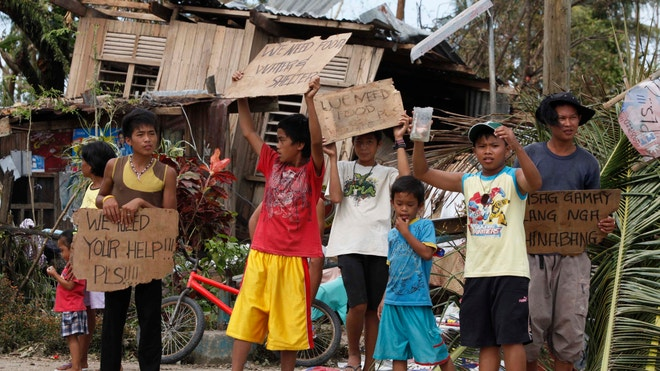 Children Hold Signs Typhoon Haiyan, Philippines
