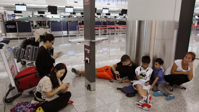 smartphone charging airport