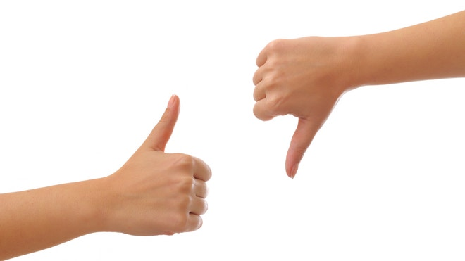 thumbs up thumbs down - istock