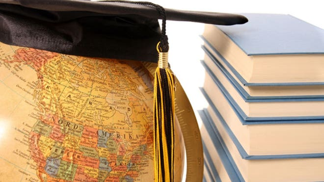 College Graduate Cap on a Globe With Text Books