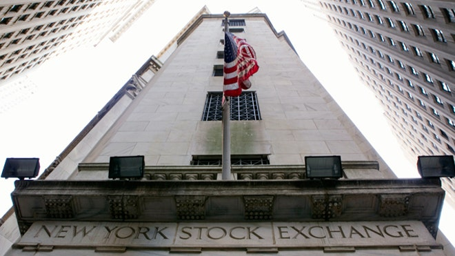NYSE Building with U.S. Flag Hanging, Reuters