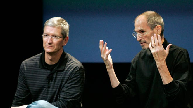 Tim Cook and Steve Jobs,