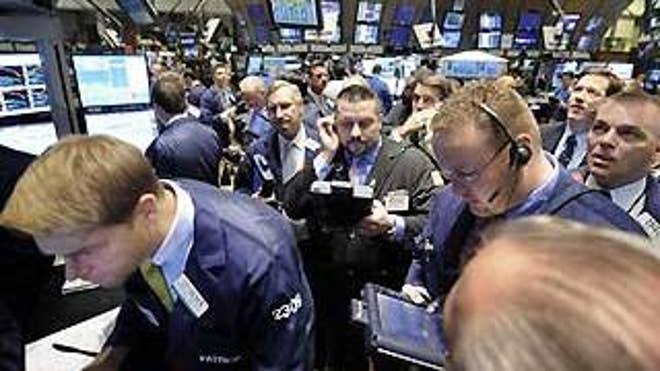 Friday: Traders on Wall Street gather at the post that handles Citigroup (AP Photo).
