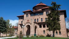 Perched atop a bluff in the remote Black Hills, a veterans hospital built of thick blocks of pink sandstone and topped with red-tiled roofs in a Spanish mission style overlooks the tiny town of Hot Springs, South Dakota, and has provided recovering soldiers a bucolic haven for more than a century.