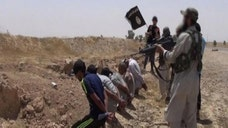 Islamic State militants moved on Saturday to stamp out dissent in a remote western Iraqi town, detaining at least  and tying dozens of residents, including tribal leaders, to streetlight poles as a punishment, security officials said.