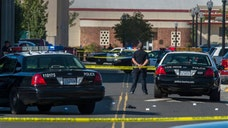 California law enforcement officers searched for a gunman Friday after one man was killed and two others wounded in a parking lot near a Sacramento community college campus, officials said.