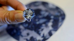 Sotheby's says a rare blue diamond offers marketed for a record $
