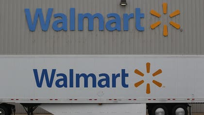 Wal-Mart Stores Inc (WMT.N) said its U.S. units were asking meat suppliers to reduce the use of antibiotics in animals, joining the list of U.S. companies that have responded to consumer and government concerns over the excess use of drugs in livestock.
