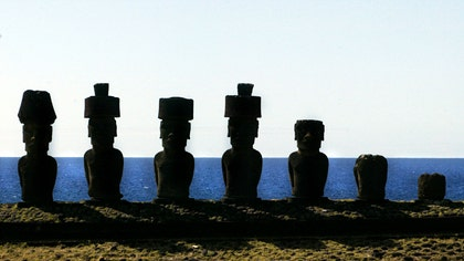 The distinctive headgear worn by some of the famous Easter Island statues may have been rolled up ramps to reach those high perches, a new study suggests