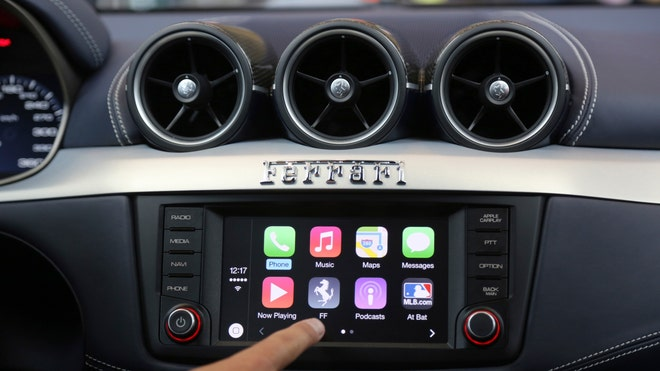 As we head out for our final summer road trips, many of us--whether we admit it or not--will be juggling an iPhone to keep us connected in the car. It can be a dangerous distraction, but one that many people hope will be mitigated when Apple's much-anticipated CarPlay software comes out this fall.