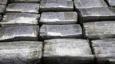 Peruvian police displayed in a Lima airport police hangar on Monday what officials called the largest cocaine haul ever in the Andean nation, . tons.