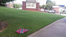 Authorities were searching late Thursday for two men caught on surveillance video placing Confederate battle flags around the Atlanta church where Martin Luther King Jr. once preached.