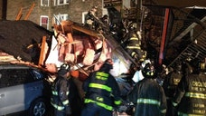 Two women and a dog have been rescued from the rubble of a Chicago apartment building that collapsed Sunday evening on the city's South Side.