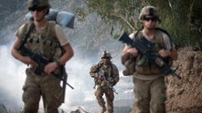 Afghanistan's parliament approved agreements Sunday with the U.S. and NATO allowing international troops to remain in the country past the end of this year amid a renewed offensive by Taliban militants.