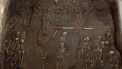 Archaeologists undertaking excavations at the University of Cambridge in England say they've discovered one of the largest medieval hospital cemeteries in the U.K., containing the remains of around , people, including approximately  complete skeletons.