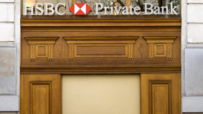 Geneva prosecutors searched the premises of HSBC's Swiss subsidiary on Wednesday after launching a money-laundering investigation over a report that the bank helped hide millions of dollars for drug traffickers, arms dealers and celebrities.