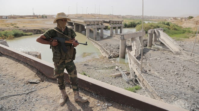 A senior Iraqi commander in the western Anbar province says at least  soldiers were killed in recent suicide bombings carried out by Islamic State militants and another  have been captured.