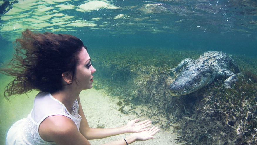 Scaly snaps: Model poses face-to-face with crocodiles in Mexico