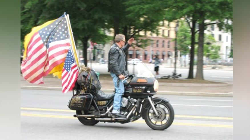 David Zien, seen here on one of his previous motorcycles, was told by Harley-Davidson that the warranty on his new bike was void because of the flags he let fly from the rear. (Courtesy: BikerNet.com)BIKERNET.COM