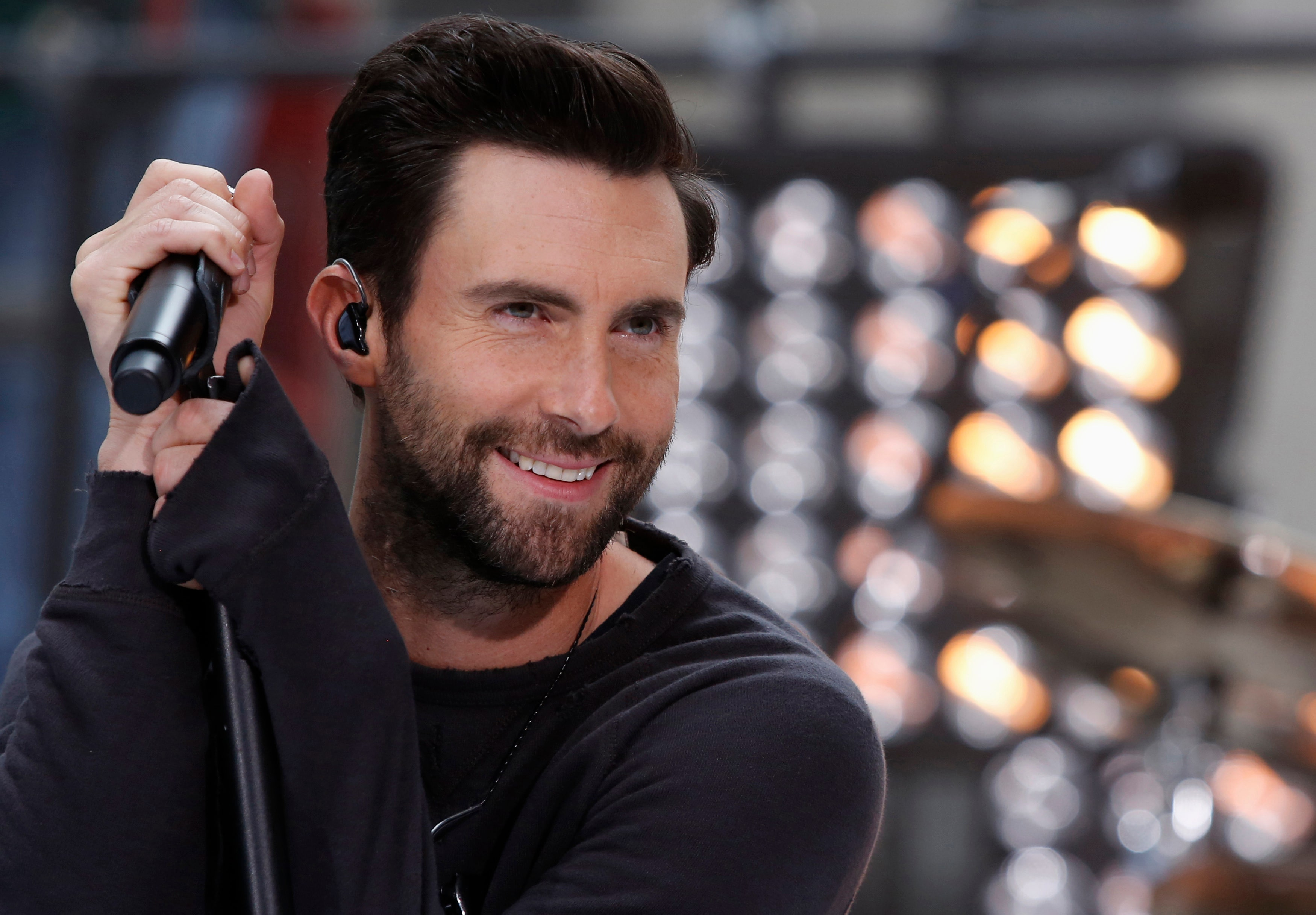 Adam Levine Throws Microphone Accidentally Hits Fan In
