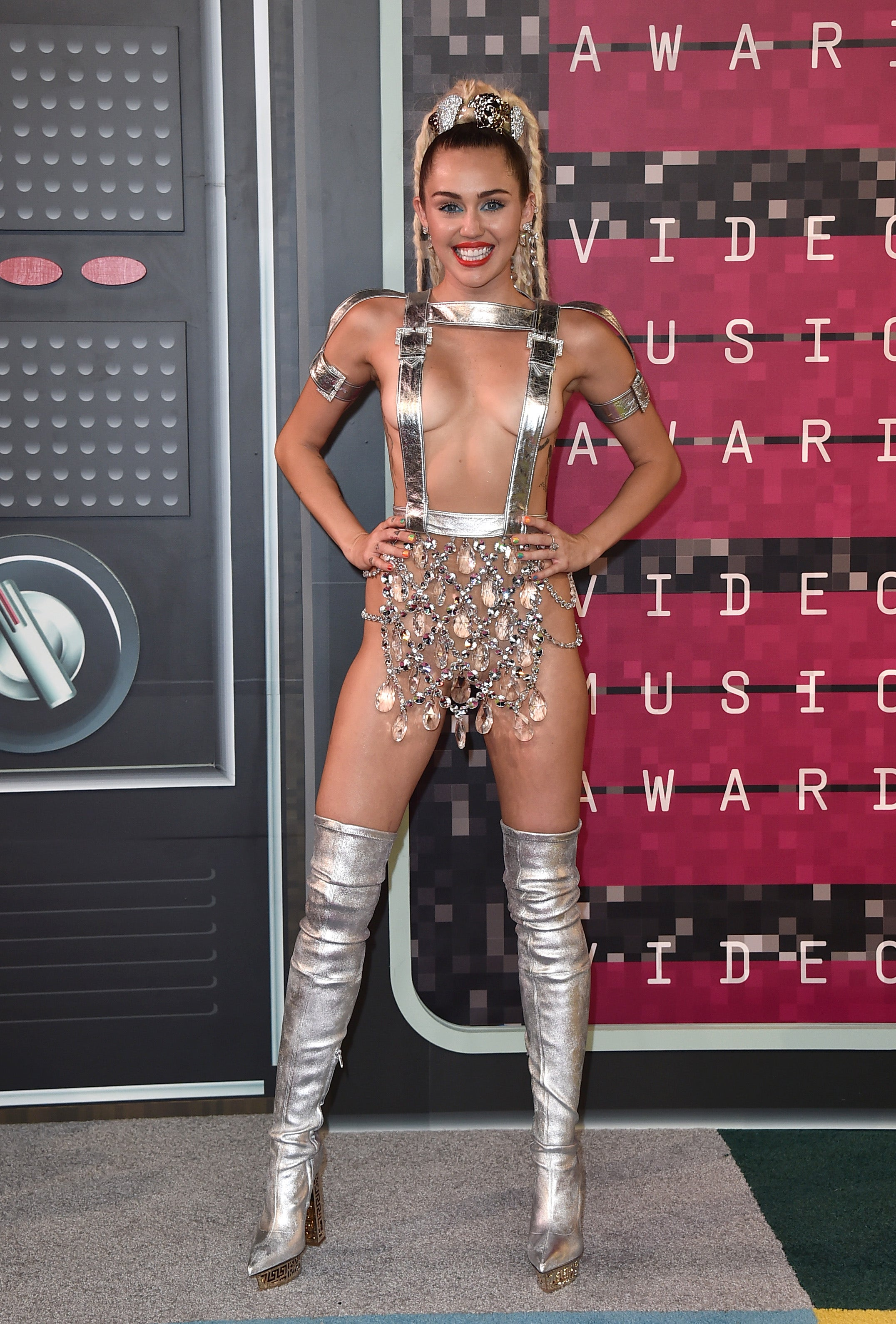 miley cyrus hosts vmas in barely there silver straps fox