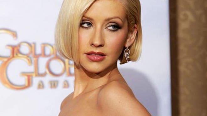 Semi-nude photographs of Christina Aguilera were circulating online ...
