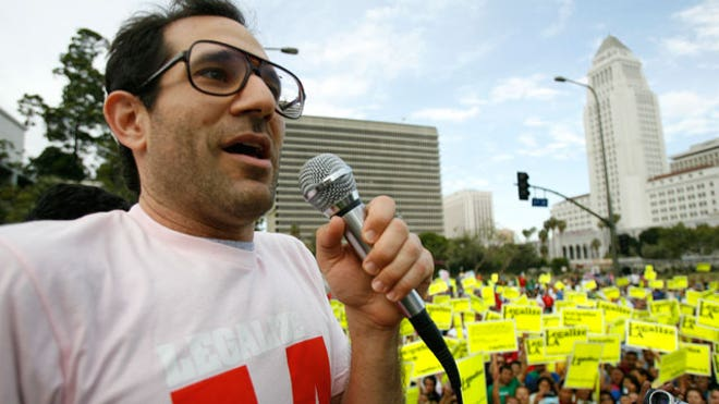 May 2009: American Apparel founder Dov Charney speaks at a rally in this ...