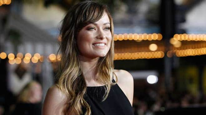 olivia wilde red carpet 2011 smile