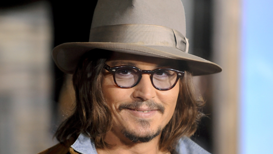 johnny depp rango smiling 640