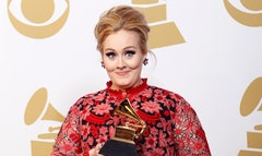 British singer Adele's toddler son has won a five-figure sum in damages after paparazzi photographed private family moments.