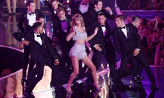 "As expected, Taylor Swift shook what her mama gave her on Sunday's MTV Video Music Awards. The -year-old performed her new single ""Shake It Off"" with a bevy of suited male dancers."