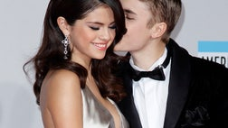 The Biebs is just like any -year-old boy in love with his first serious girlfriend, -year-old cutie Selena Gomez.