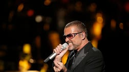 George Michael's publicist says the singer is being treated for minor injuries after he was a passenger in a car crash.