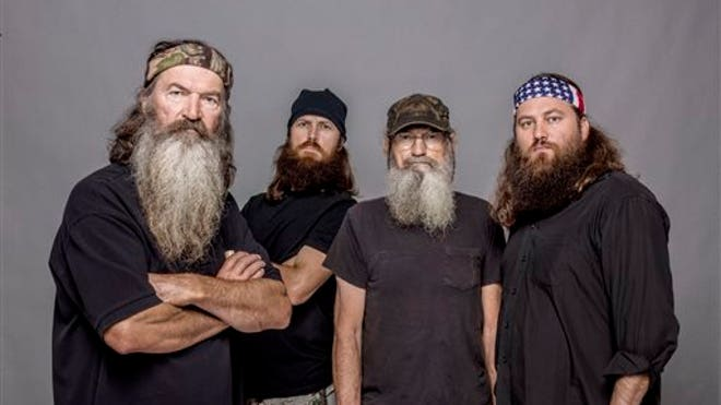 this 2012 photo released by a e shows from left phil robertson jase ...