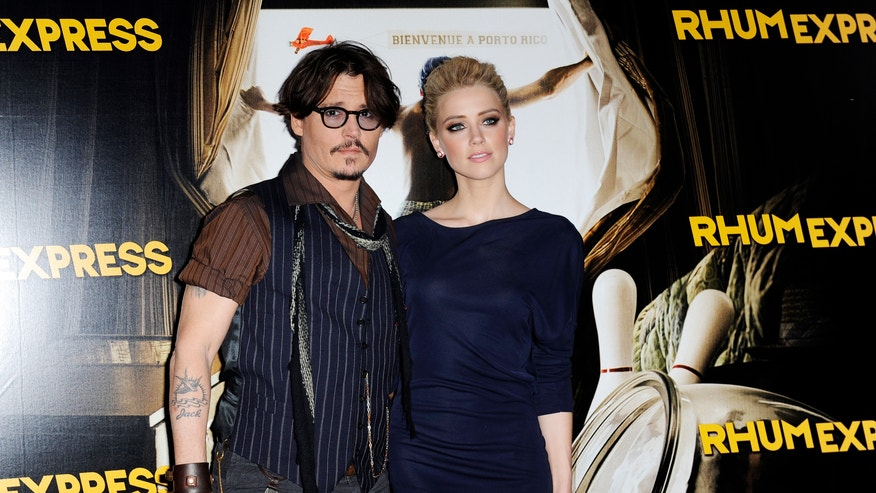 Johnny Depp and Amber Heard 660 reuters.JPG