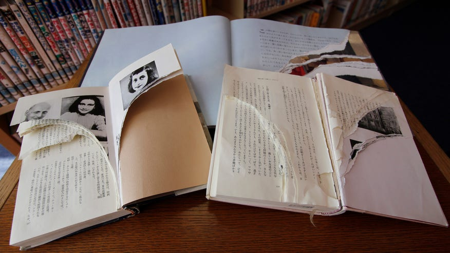 Scores of Anne Frank books defaced in libraries across Japan