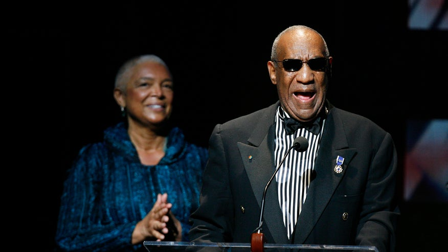 Bill cosby addresses the crowd in front of his wife camille cosby