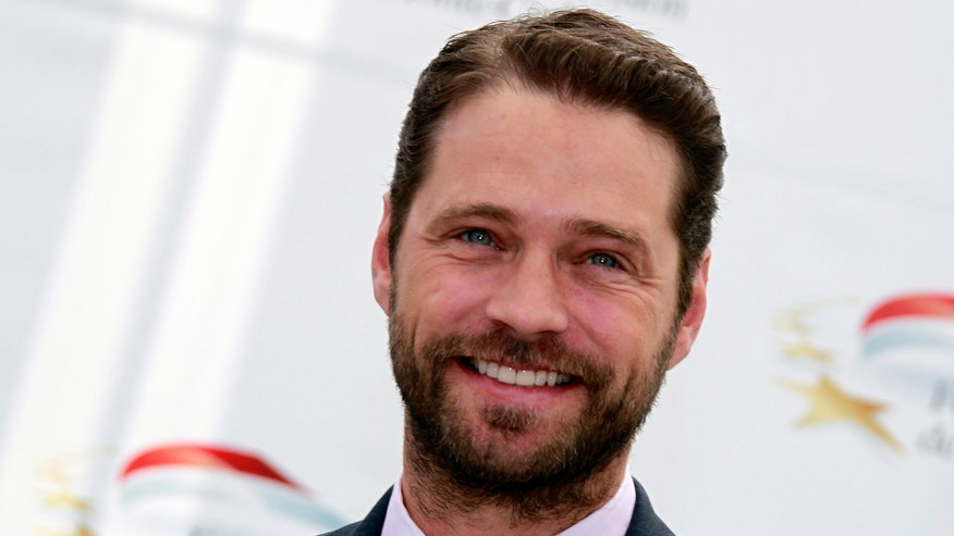 jason priestley smile and beard reuters.jpg