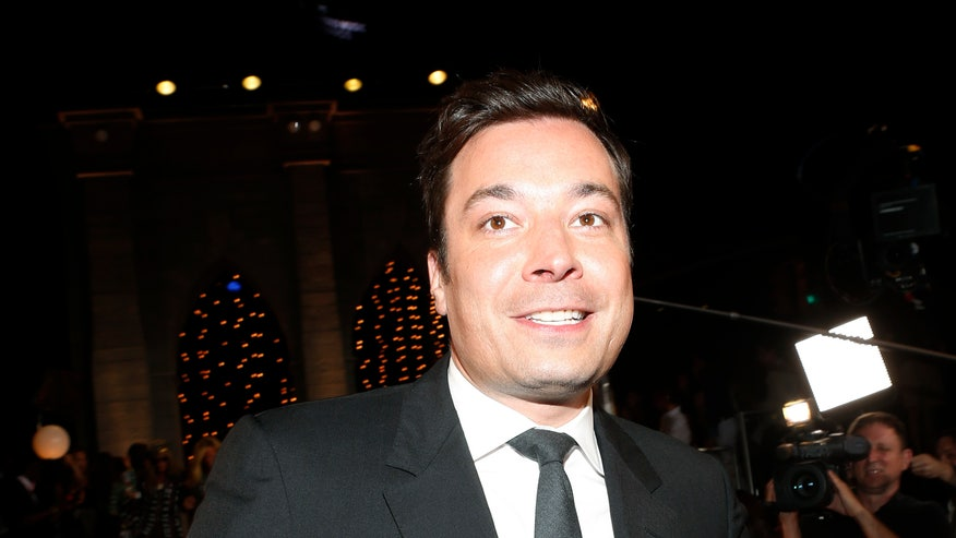 jimmy fallon touches suit reuters.jpg
