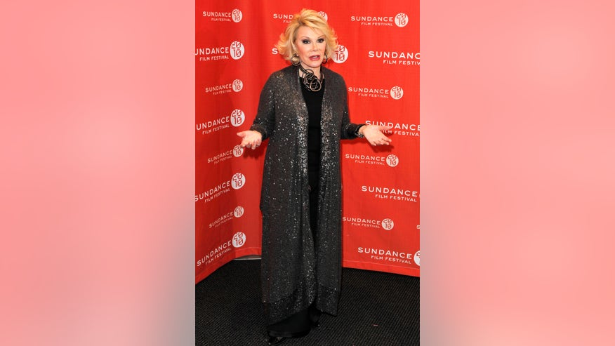 joan rivers hands out reuters.jpg