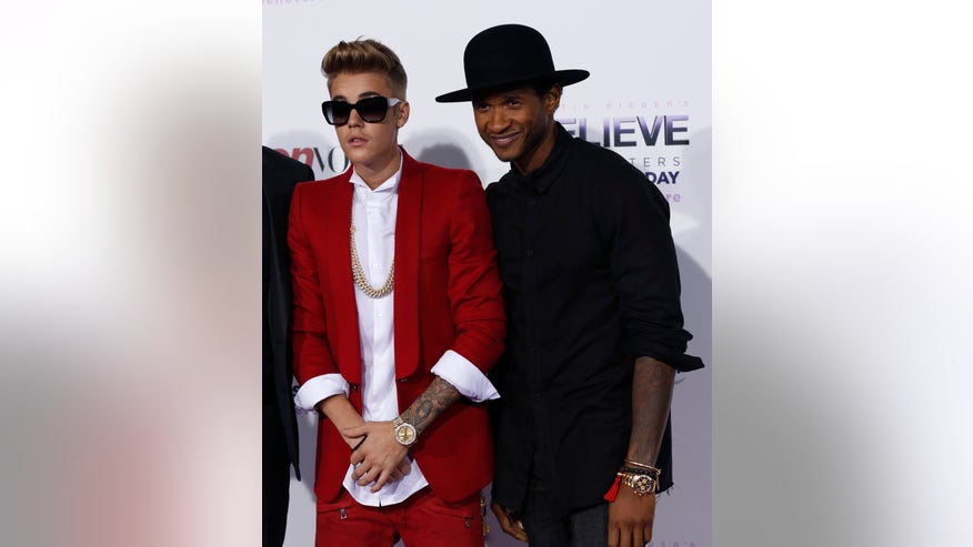 justin bieber and usher pose reuters.jpg