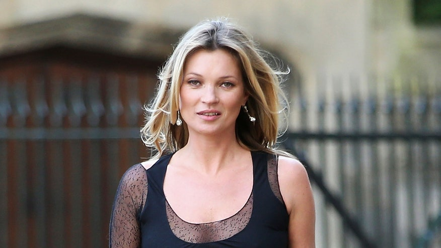 Kate Moss drinks from glass modeled after her breast